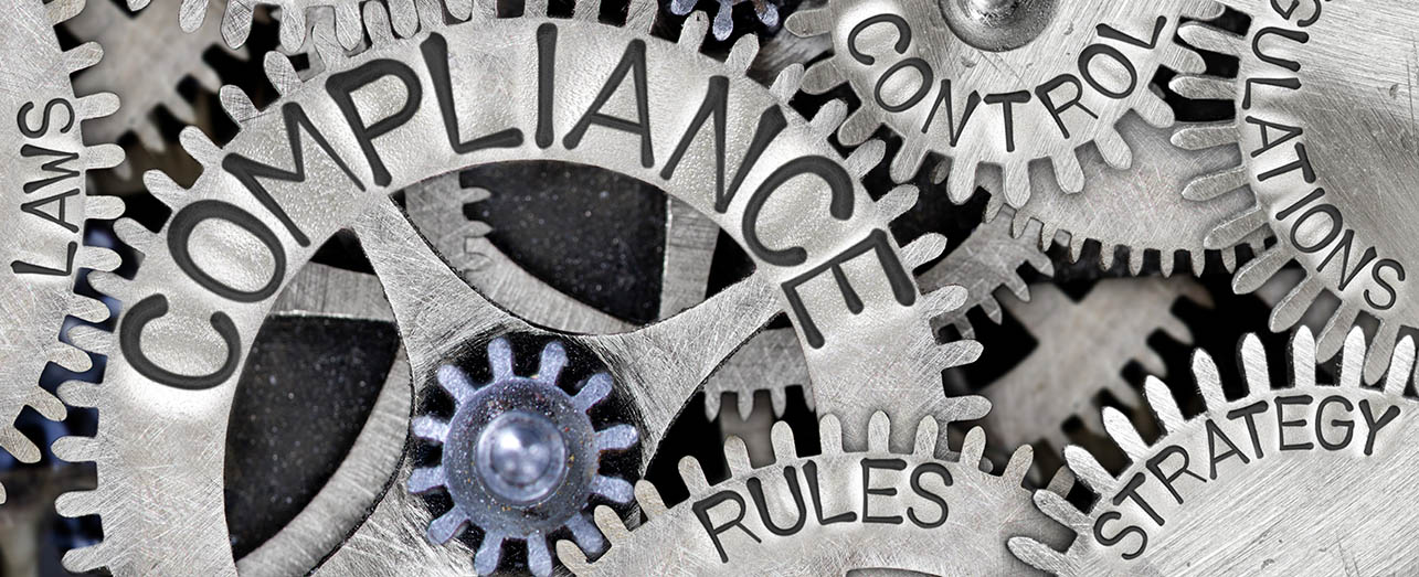 "cogs with words written on them - ""laws"", ""compliance"", ""control"", ""rules"", ""strategy"" and ""regulations"""